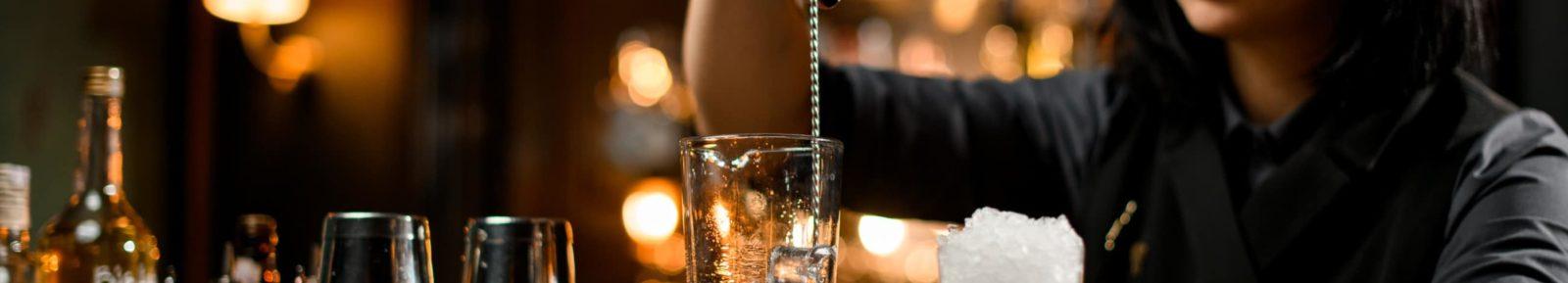 Bartender stirring ice